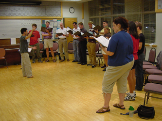 Choir rehearsing in the dance room